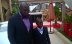 Le patron de l'UJTL, Dr Toussaint Manga célébrant Noël en compagnie de son fils